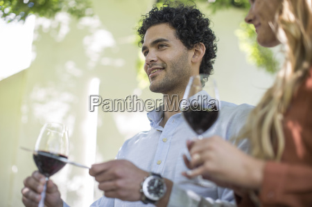 young man with wine glass making