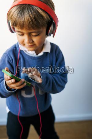 little boy listening to music of