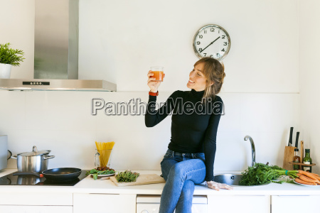 young woman drinking fresh grapefruit juice