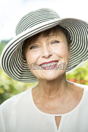 portrait of smiling senior woman wearing