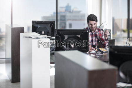 man at desk in office looking