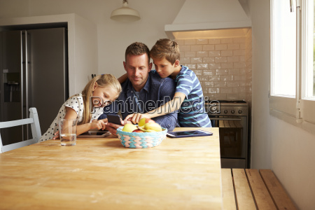 children looking at mobile phone with