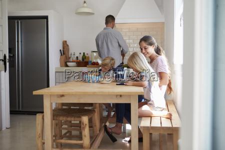 kids do homework at kitchen table