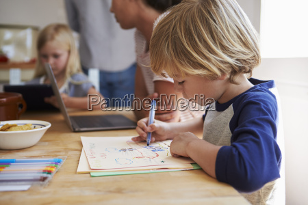 kids working at kitchen table with