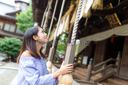 woman wishing and ringing the bell