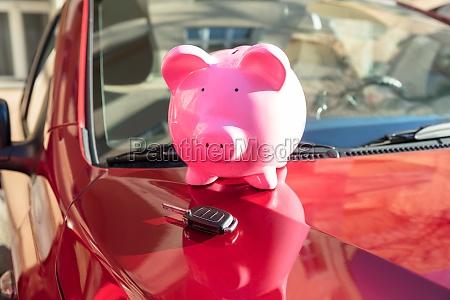 piggybank with car key on car