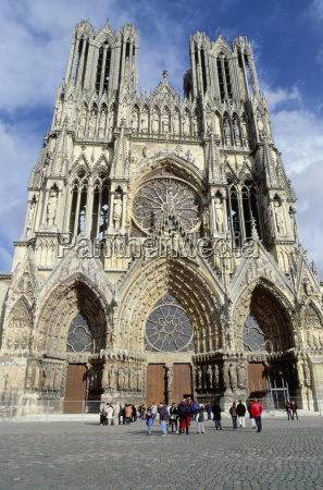 tourists outside reims cathedral dating from