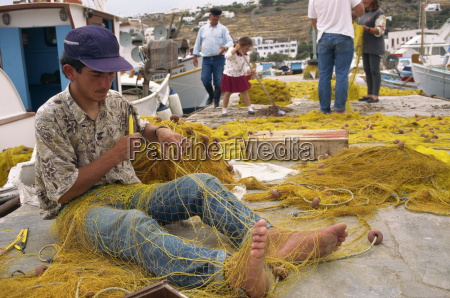 fisherman using hands and feet to