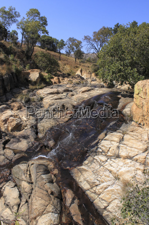 water trickling over sand coloured rocks