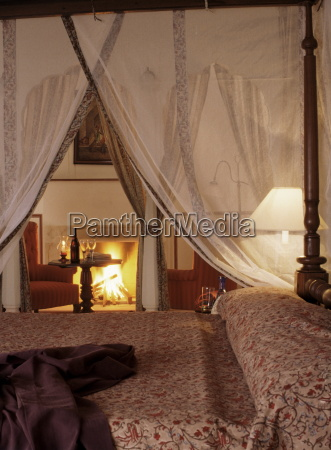 guest bedroom with roaring log fire