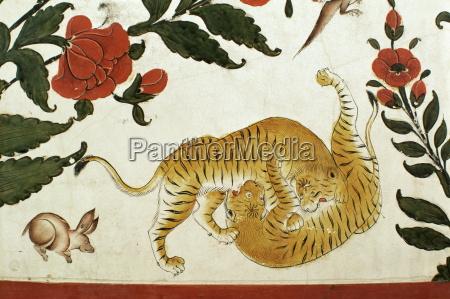 detail of fighting tigers on painted