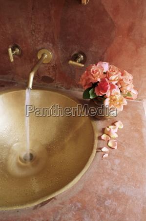 detail of brass hand beaten bathroom