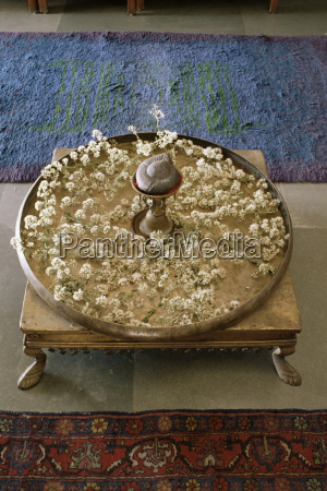 flower arrangement in traditional brass thali