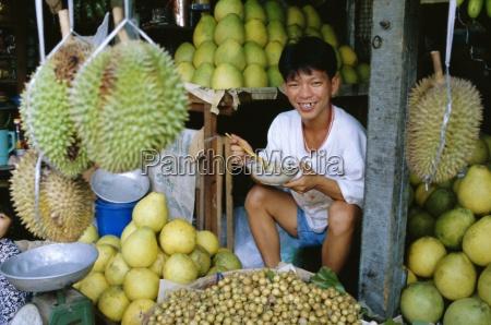 fruit seller in market ho chi