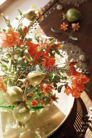 pomegranate flower and fruit arrangement on