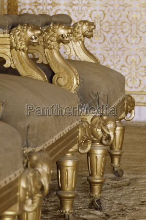 detail of gilt chairs in the