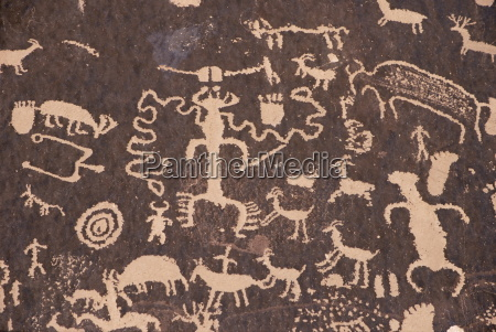 indian petroglyphs drawn on red standstone