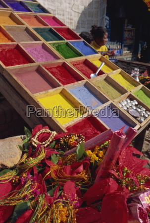 stall selling coloured powder for rituals
