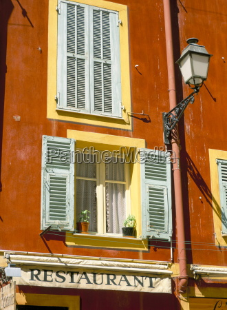 architectural detail of lamp and shuttered