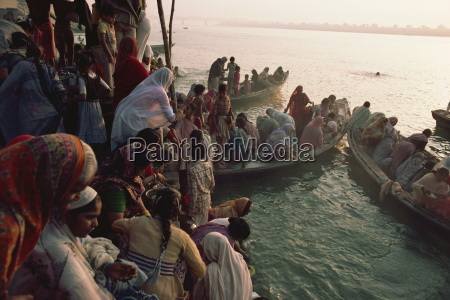 women take to boats on the