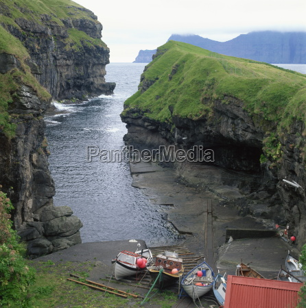 fishing boats in a cove at