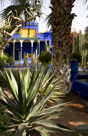 a cobalt blue pavilion surrounded by