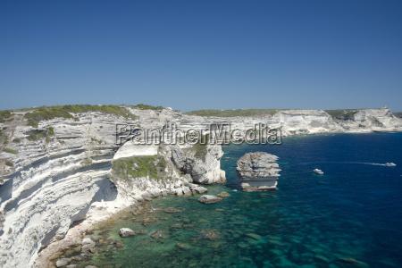 white limestone cliffs above emerald sea