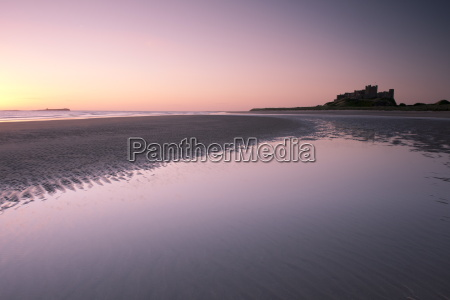 bamburgh castle and the beach at