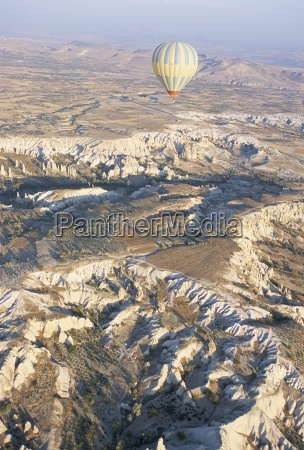hot air ballooning over rock formations