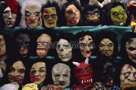 rows of halloween masks on sale