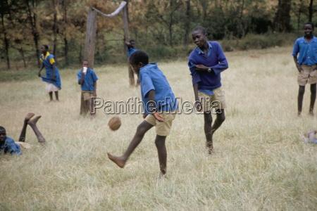 school children playing football western area