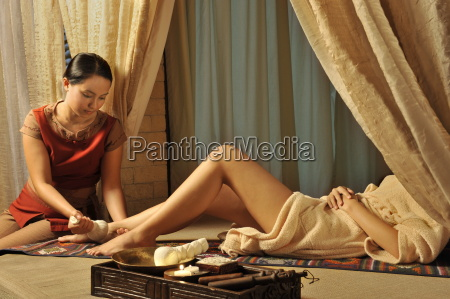 treatment for feet with herbal pouch