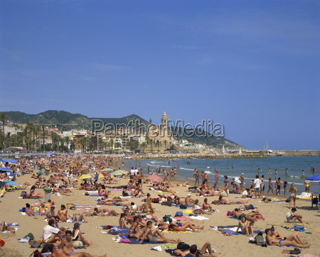 crowded beach at sitges costa dorada