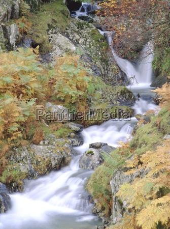 stream tumbling over rocks lake district