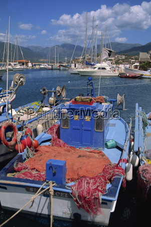 fishing boat moored in the harbour