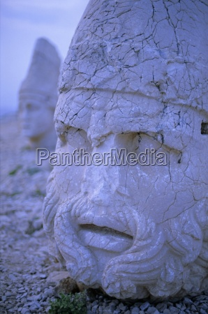 ancient carved heads of gods on