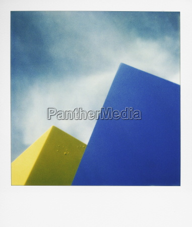 blue and yellow shapes against sky