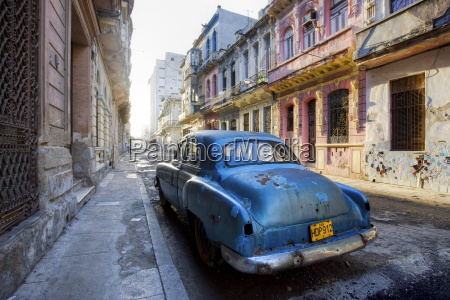dilapidated american car parked on a