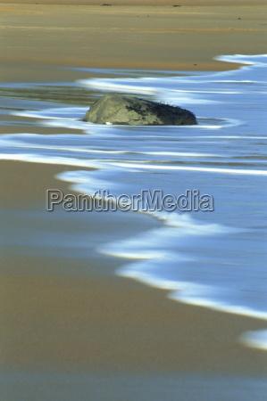 waves breaking on beach northumberland england