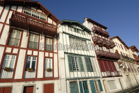 colourful old houses along harbour of