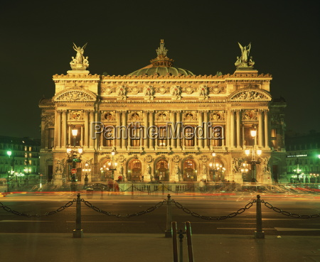facade of lopera de paris illuminated