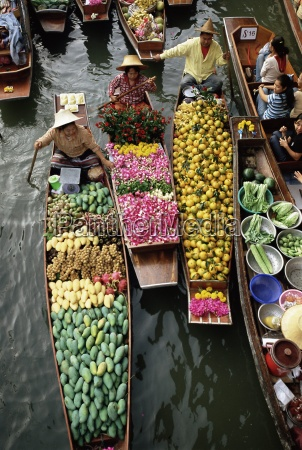 market traders in boats selling flowers