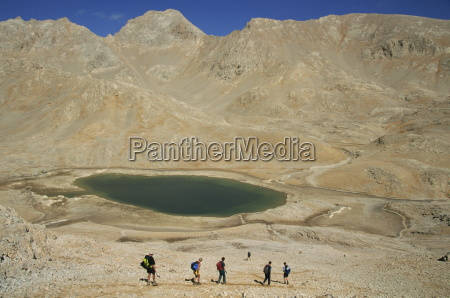 trekking past lake on yedigoller plateau