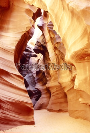 coloured rock in waves formation in