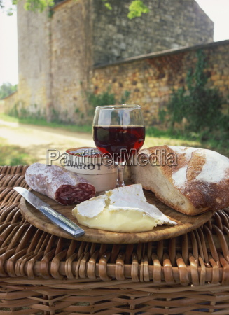still life of bread glass of