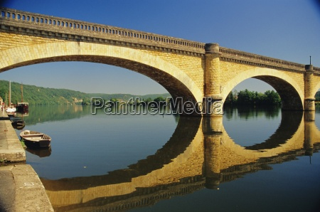 reflections of a bridge in the