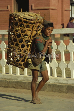 man working as a porter carrying