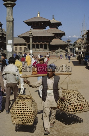 nepali man carrying produce in wicker