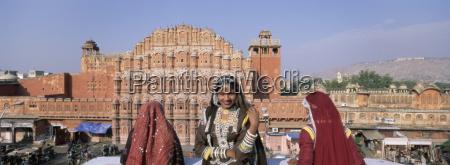 women in saris in front of