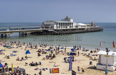 west beach and pier with calm